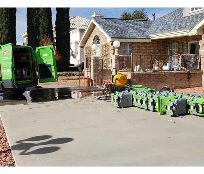 Green SERVPRO Truck Next To Green Air Movers and Dehumidifiers