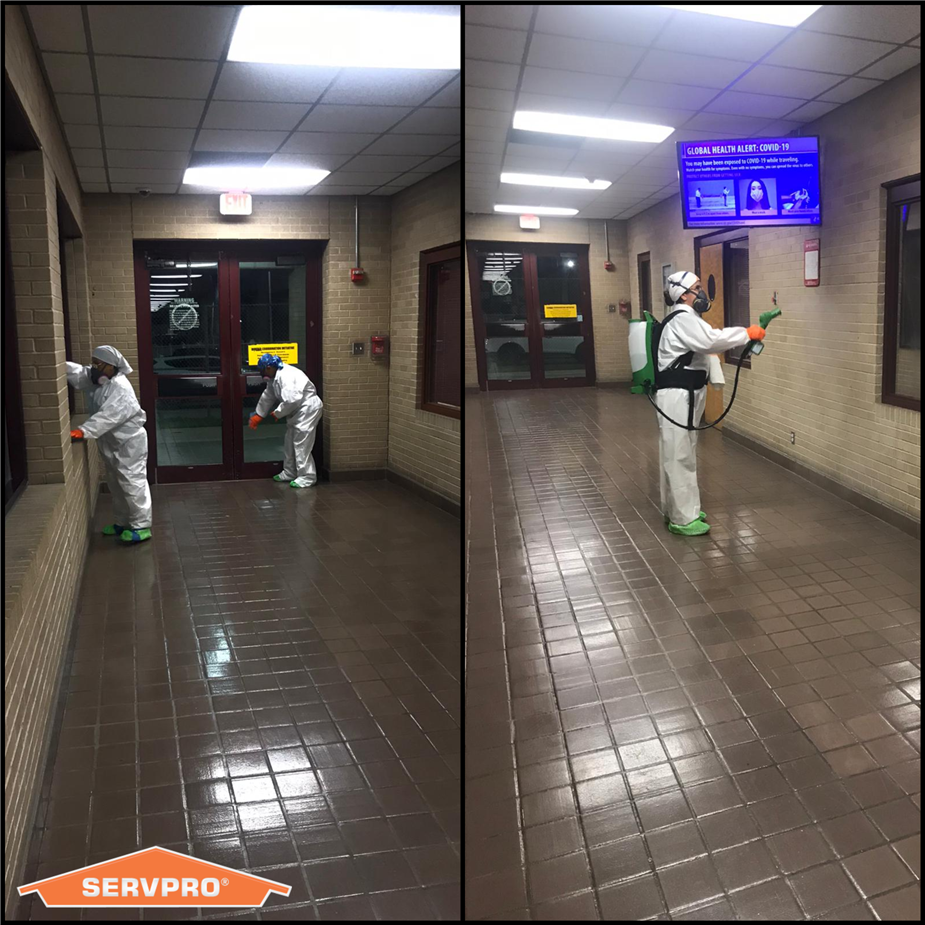 SERVPRO technicians in PPE Suits Cleaning a Business by Spraying and Wiping Down